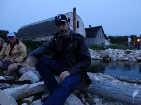 Mark and I found a place to sit on a rocky pier.