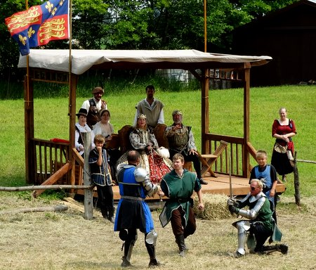 The green knight was wounded and his page tried to defend him.
