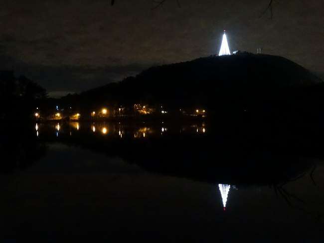 The tower at the top has been turned into a lighted tree that reflects in the water.