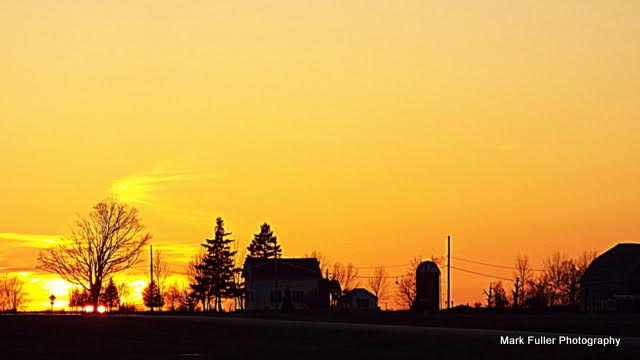 Sturgen Bay farmhouse at sunset.